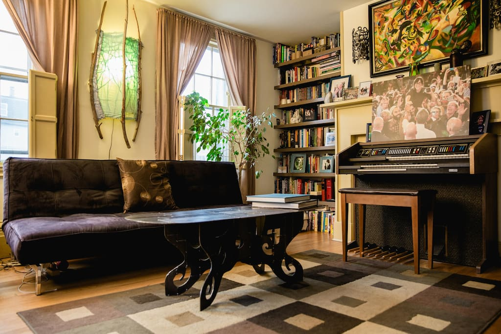 Take a load off in the living room! Play the organ, read a book, or look at pictures of our friends and family.  This is the additional room that we rent out if your party contains more than two adults.