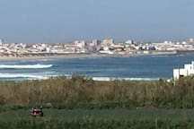 The view of the beach and waves from the roof terrace