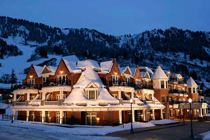 Ground level exterior view of the Hyatt Grand Aspen in Winter.
