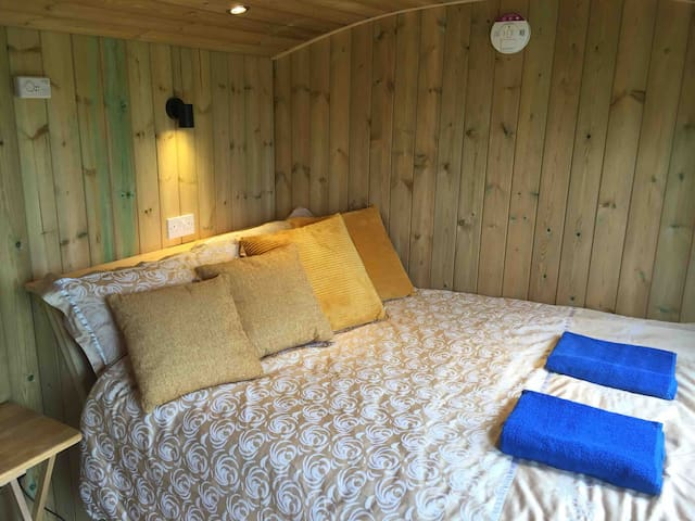 The double bed has wonderful views across the valley to the Welsh hills.