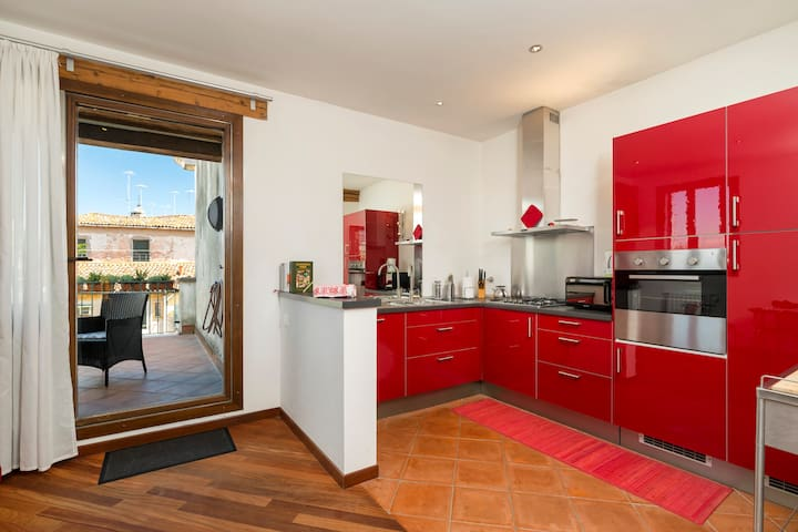 KITCHEN AND VIEW OF THE PRIVATE TERRACE