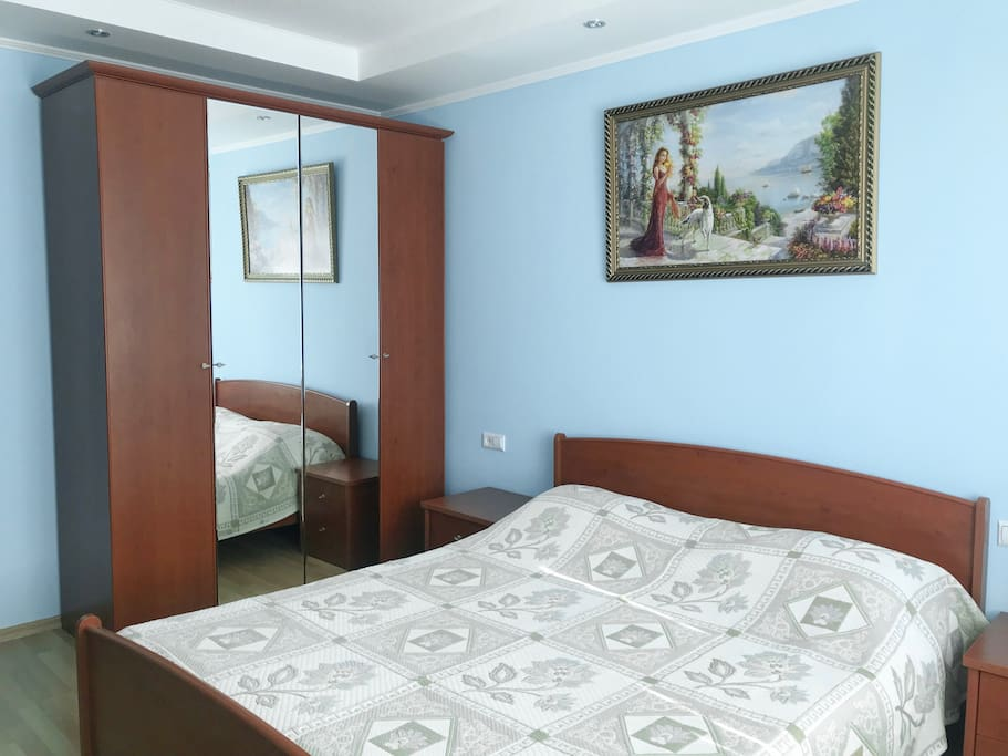 Bedroom with double bed and wardrobe set