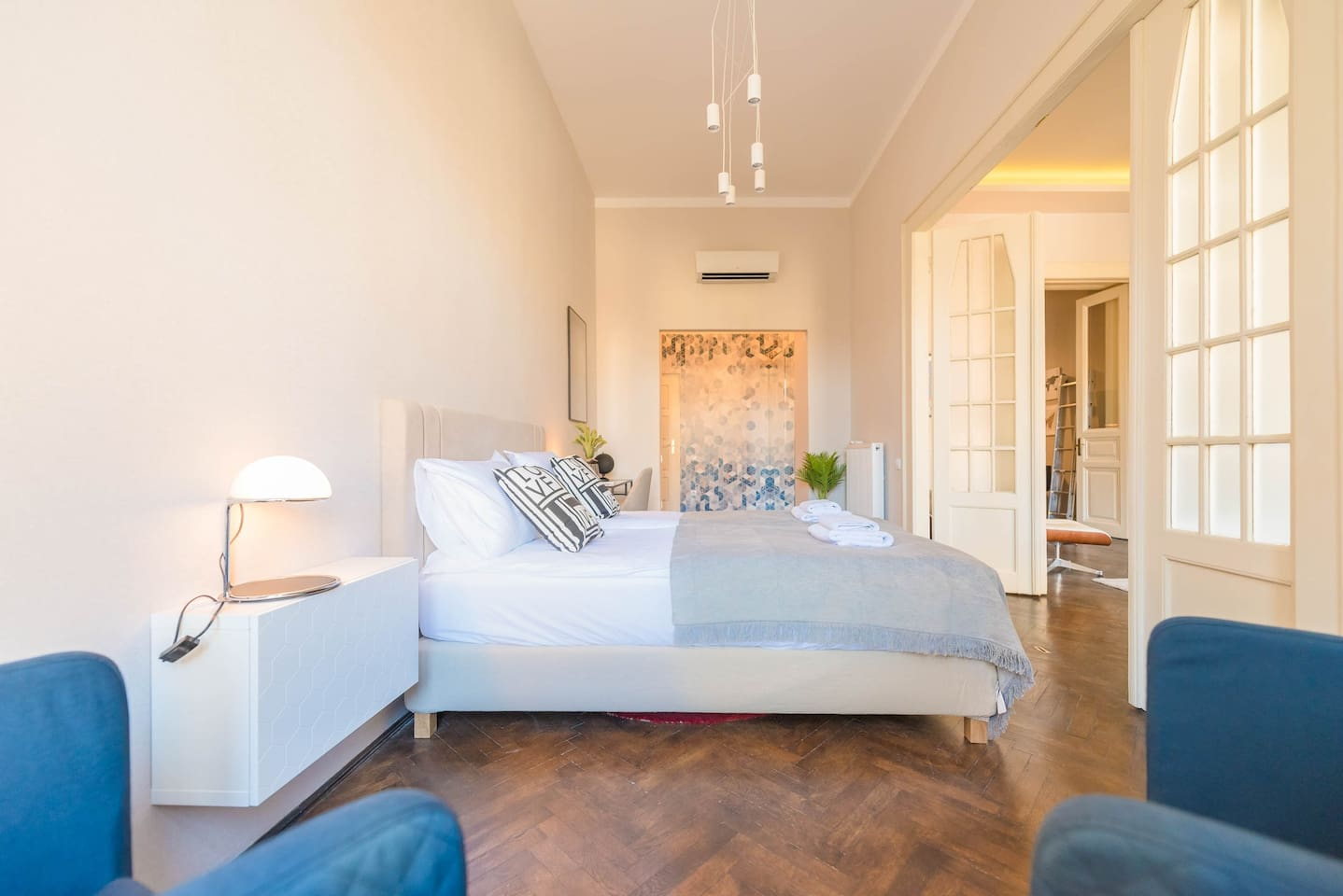Second bedroom with king-sized bed, luxury linens, walk-in-wardrobe and en-suite bathroom.