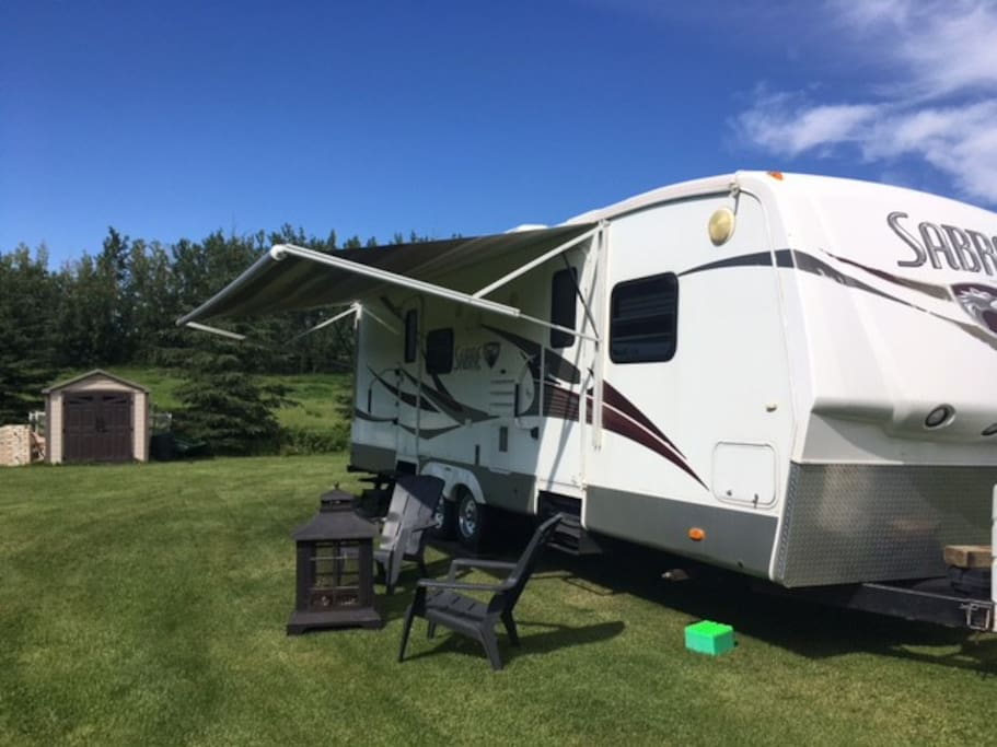 28' sabre sleeps 6. Fire pit and picnic table right outside your door.