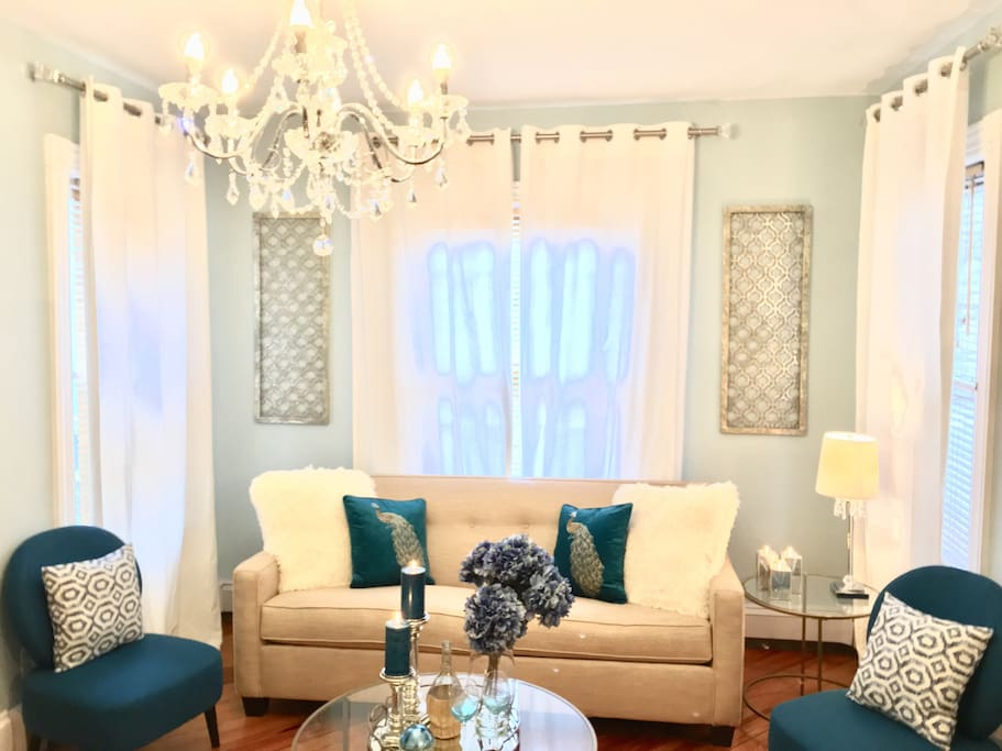 Elegant sun filled living room.  Sofa has a queen size Posturepedic mattress to assure you sleep comfortably.