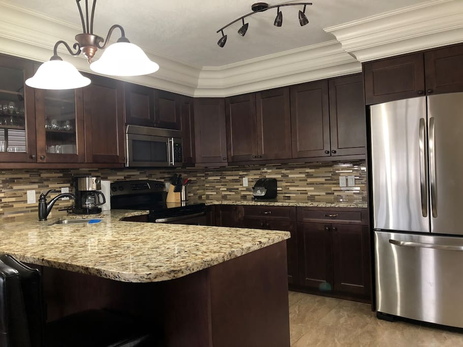 Granite counters and quality stainless steel appliances