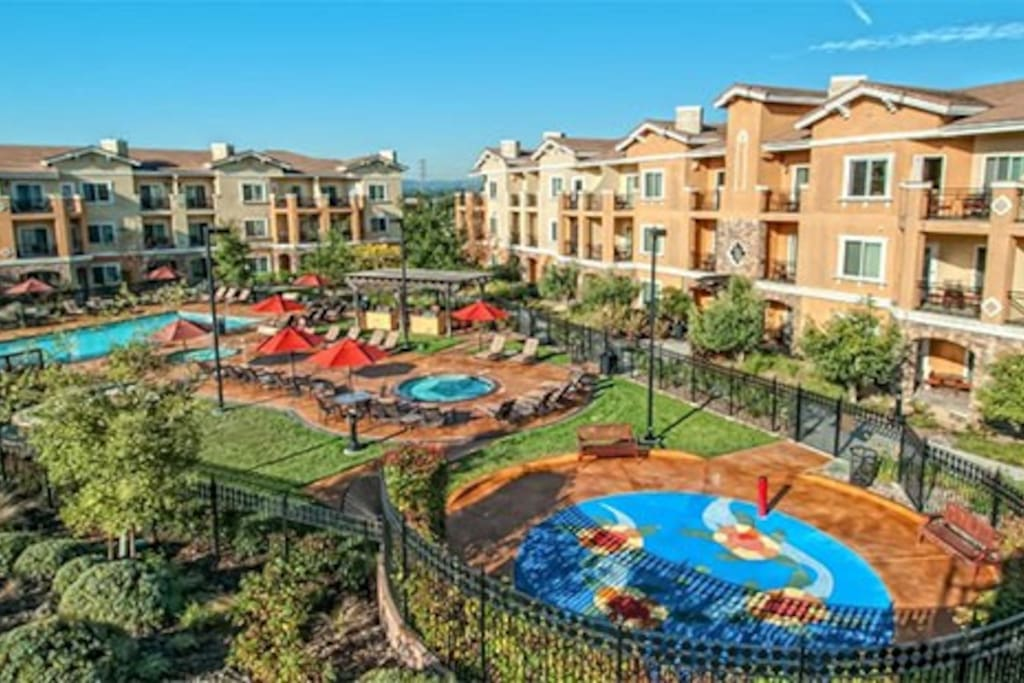 Vino Bello pool, outdoor BBQ area, & kids play area