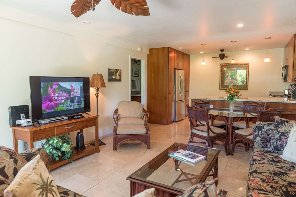 Beautiful Great Room with Lovey Island furnishings and Large Flat-Screen TV