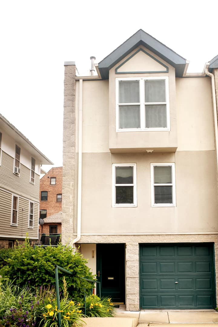 Lovely End Unit OP Townhouse with parking & yard.