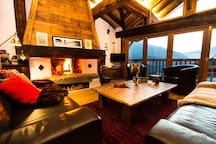 Relax in front of the roaring fire after a day on the piste!
