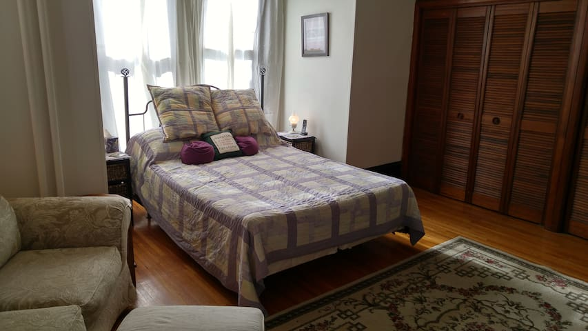Queen size bed with a handmade quilt.