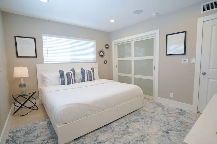 Spacious Bedroom Two Features King Bed + Samsung 4K Smart Streaming TV + Full Size Closet + Overlooks Private Pool Lounge Area...