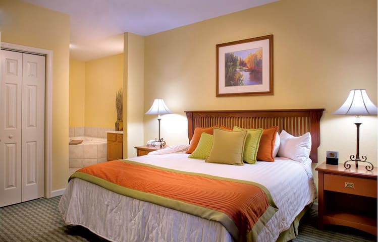 The king-sized bed in the master bedroom is sure to provide a comfortable sleep