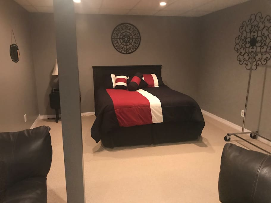 Your queen bedroom space with clothes rack!