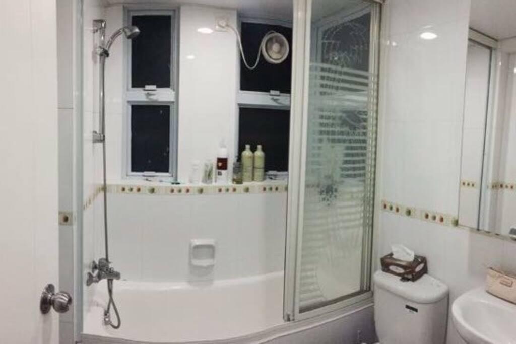 Modern, clean bathroom with shower and bath tub