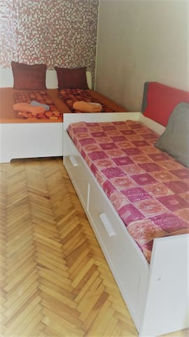 the super comfortable double bed and the single bed in the studio area