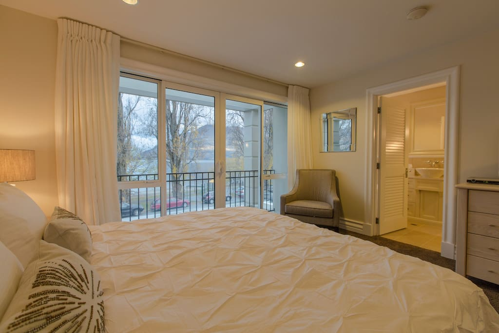 The master bedroom has a TV and private ensuite