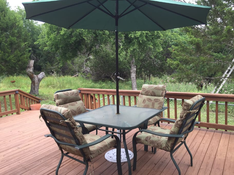 Relax with a morning cup of coffee or afternoon cold drink on the large deck and watch birds and deer
