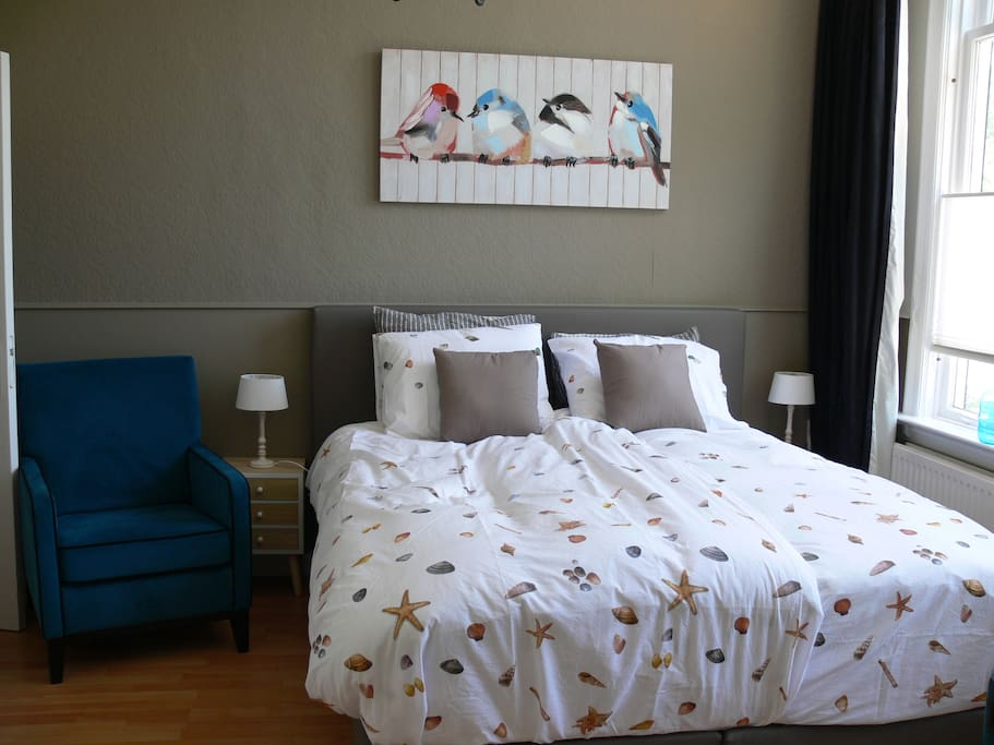 The room with double boxspring bed
