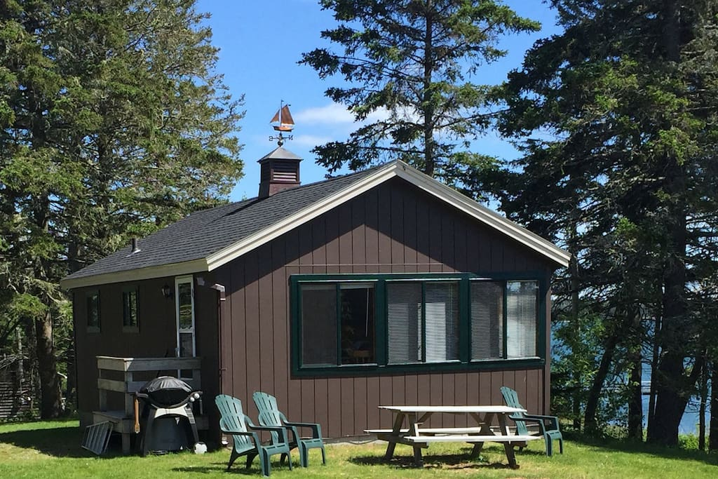 Cottage with private picnic table, chairs, and gas grill