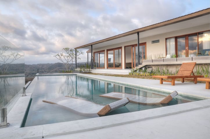 Villa Alasa idyllic eco-friendly minimalist design on a hilltop overlooking the Mandalika and Kuta beach. The design of the Villa is based on full consideration in maintaining the original landscape while maximizing the view angle of its surrounding.