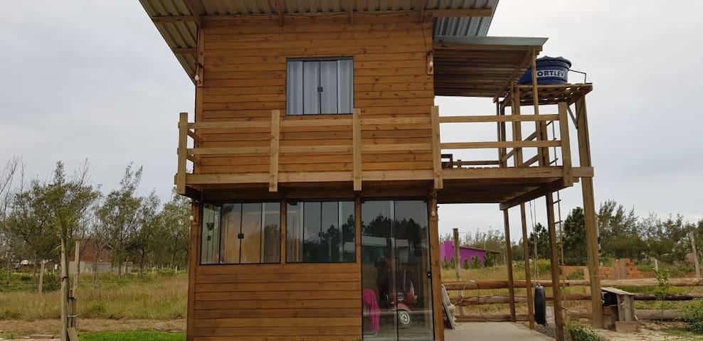 Mini casa rústica para descansar e relaxar