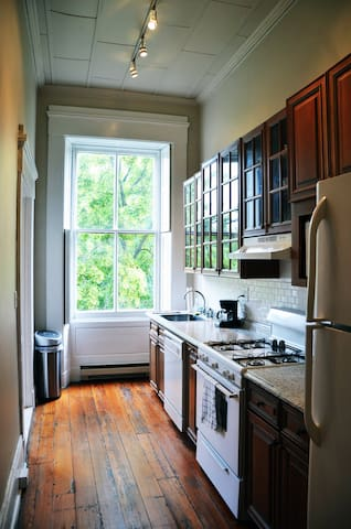 Kitchen with gas stove, microwave, dishwasher, sink, refrigerator, and coffee maker