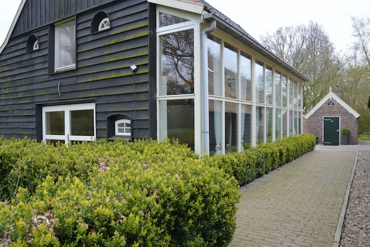 Farmhouse with indoor pool, sauna, large living room in nature area Reestdal