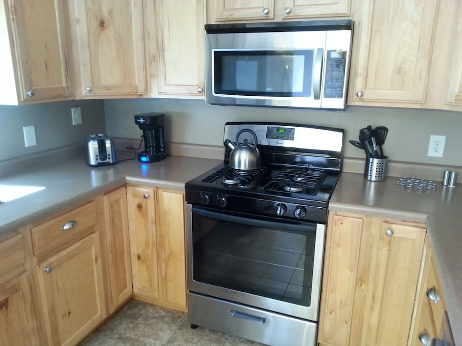Brand new stainless appliances include gas range.