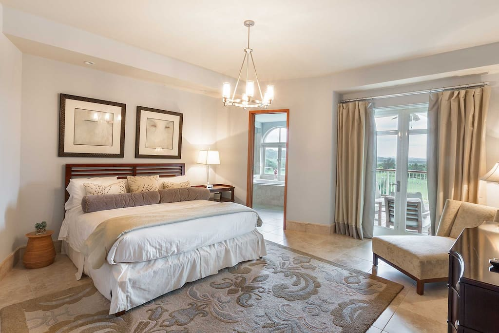 Expansive, master suite with balcony