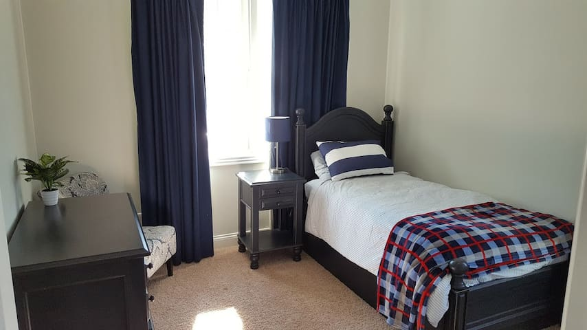 The Blue Room also has amazing views and single bed with a trundle bed as well. Also has a huge dresser and private closet.