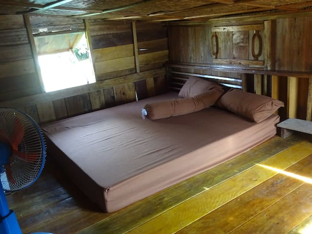 Upper level mezzanine is a cosy double bed, loft space.