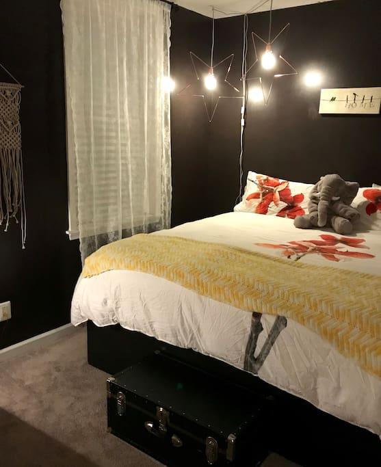 Master Bedroom - king sized bed, desk, dresser, closet & shelves.