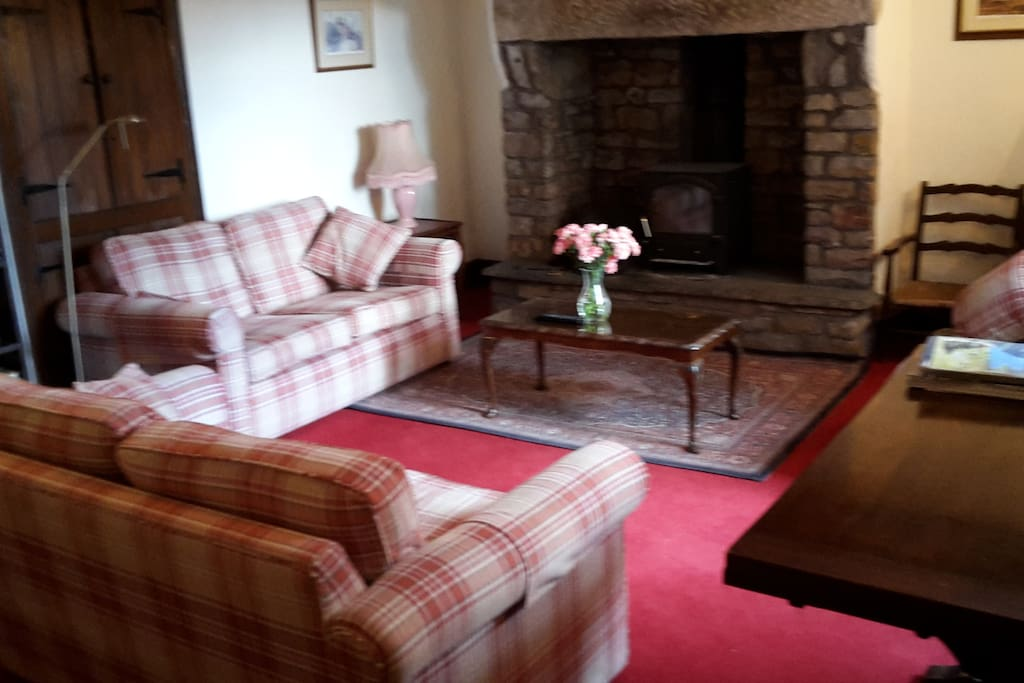 A private lounge with woodburner