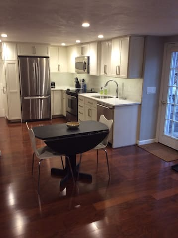 Kitchen area with full size appliances, including wine fridge.