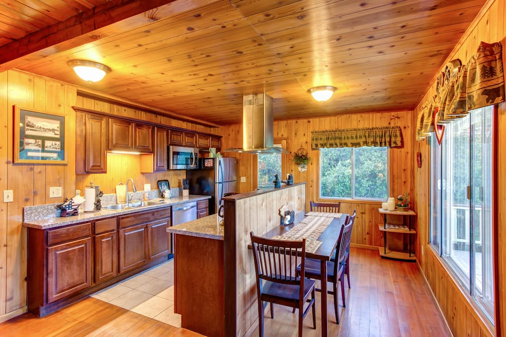 Full kitchen and dining with amazing views