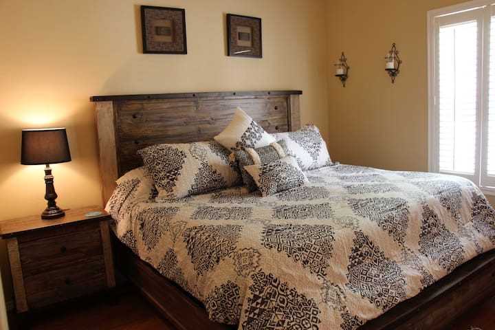 The beautiful distressed timber king bed with soft luxurious linen