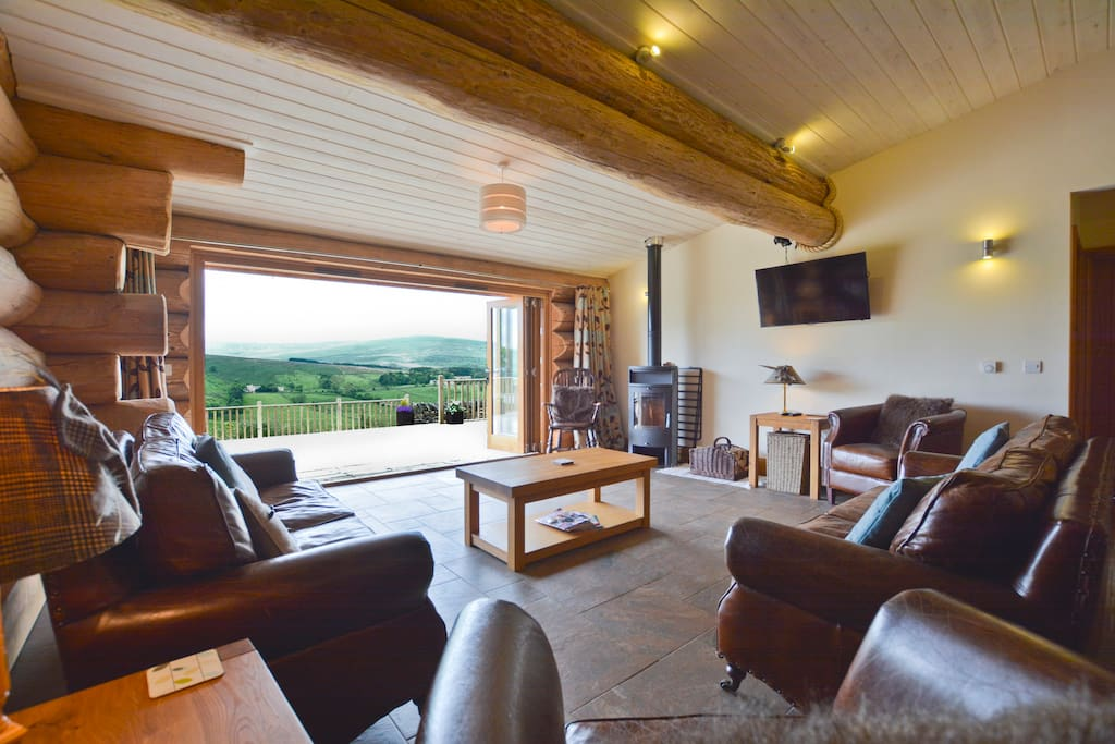 Open plan living space with log burning stove
