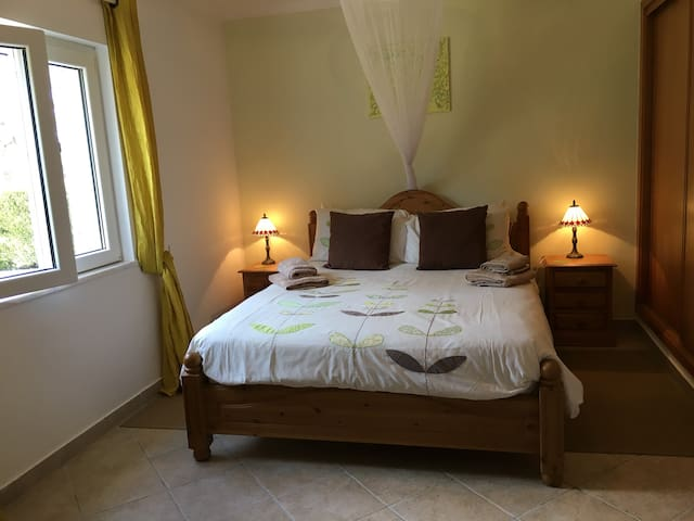Master bedroom with En-suite shower room. King sized beds, large wardrobes and window to rear garden