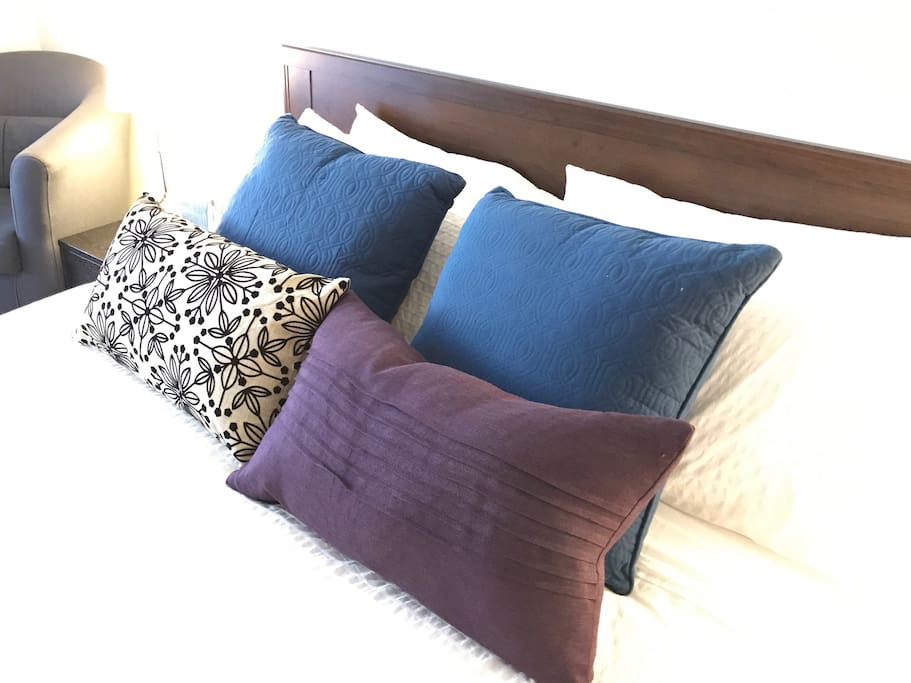 Comfy bed & lots of pillows.