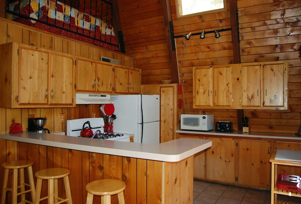 Kitchen with additional seating at bar for 3