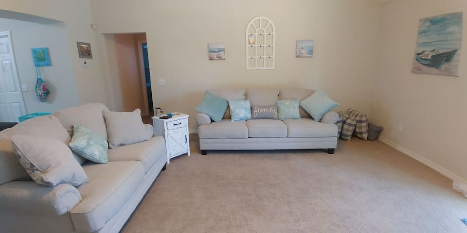 You will love this huge family room. The sofa even folds out into a queen-size sleeper that is wheel chair accessible ! We also have an over-sized recliner as well.