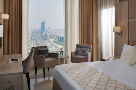 Deluxe Suite Bedroom with City View
