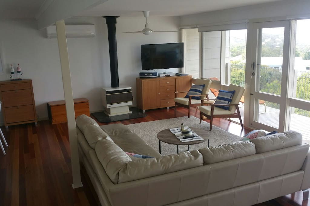 Upstairs - large living room with fire and 50' TV