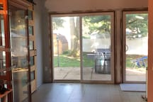 Spacious area in the kitchen with doors leading to fenced in yard. 1/2 bath on left hand side (barn door)
