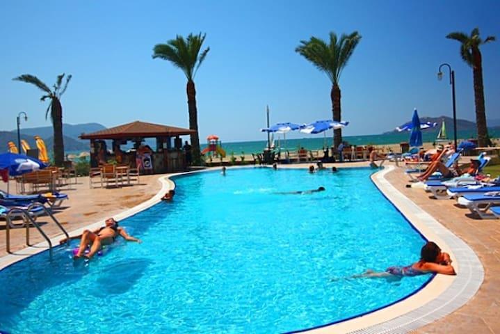 FETHİYE SUNSET BEACH CLUB 2 YATAK ODALI DAİRE1 - Fethiye - Apartment