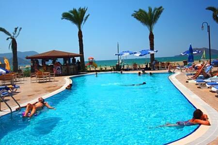 FETHİYE SUNSET BEACH CLUB 2 YATAK ODALI DAİRE1 - Фетхие - Квартира