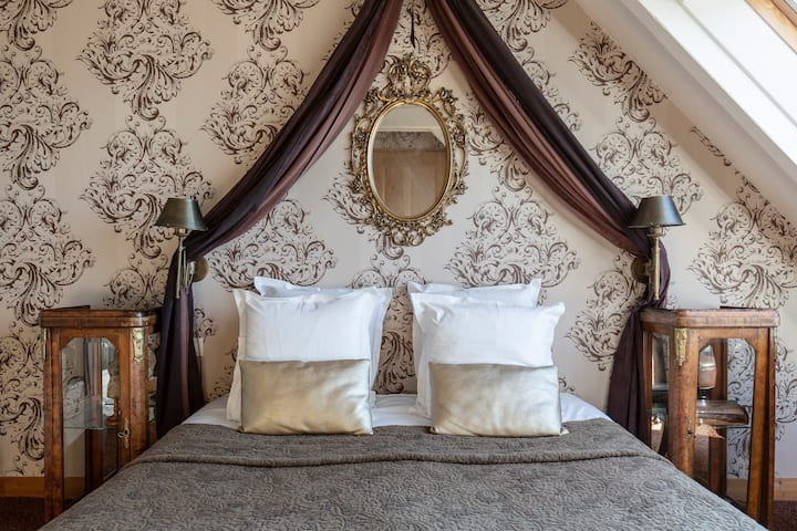 Chambre d'hôtes Bourgeoise baroque vue mer