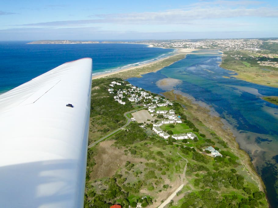 Strandmeer Estate from the air with the beautiful Keurbooms River Lagoon and our beach reserve. Why not take a glider flight over the area!