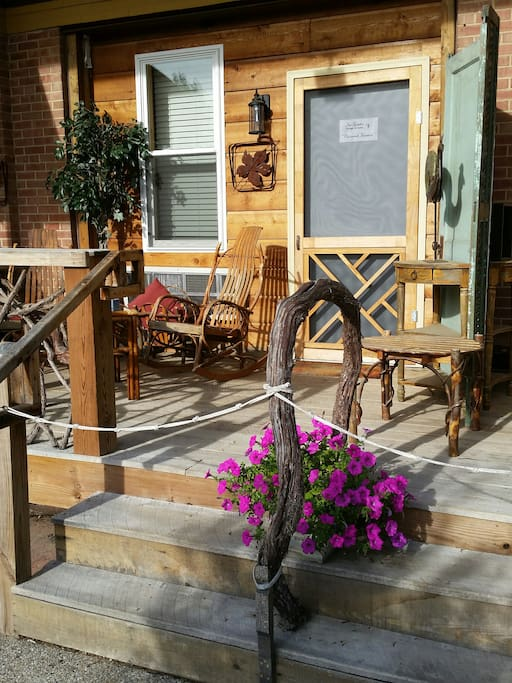A wonderfully comfortable porch w/ bent wood rockers.